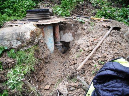 Collapsed old septic tank